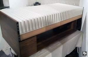 The table with its side board removed exposing the Polystyrene grid, the LED arrays and the technical compartment